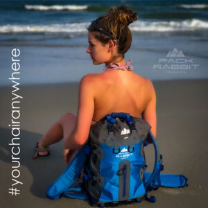 Girl sitting blue backpack seat on the beach