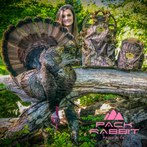 Girl showing off trophy turkey and camouflage chest pack and backpack