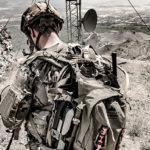 Soldier wearing tan backpack in Afghanistan