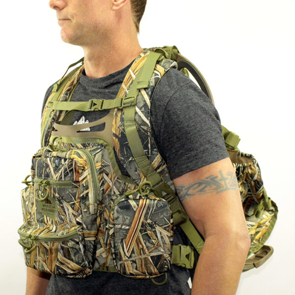 Man wearing camouflage chest pack and backpack with white background