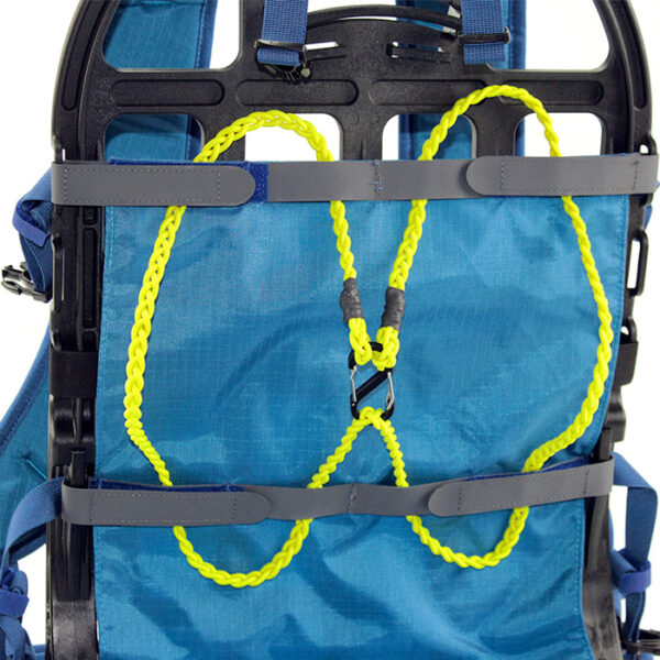 yellow bungie cord on blue backpack with white background