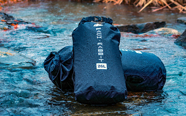 Two dry bags laying in stream