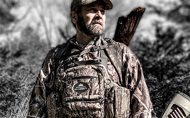 hunter wearing camo chest vest